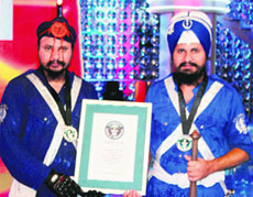 Kawaljit Singh and Gurinder Singh show their Guinness certificate.