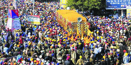 Guru Granth Sahib being taken to Gurdwara Jyoti Swarup Sahib during the Nagar Kirtan on the last day of Jor Mela