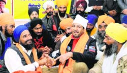 Singer Gurdas Mann with fasting leader Gurbaksh Singh Khalsa at Gurdwara Amb Sahib in Mohali.