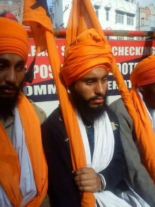 Nishanni Singh whose turban was knocked down by Punjab Police officials.