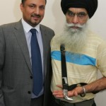Bagicha Singh, 60, (right) holding his kirpan and with his solicitor Vinod Sharma