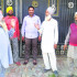 Gurbachan Singh Bhullar (in purple turban) with villagers outside his cousin Devinder Pal Bhullar's house at Dyalpura Bhaika in Bathinda