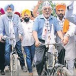 AAP's Ludhiana candidate HS Phoolka and the party's Patiala nominee, Dharamvira Gandhi, at a bicycle rally