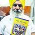 "Beant Singh with his book ""Nyare Panch Pyare"""