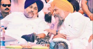 Shiromani Akali Dal candidate from Anandpur Sahib Prem Singh Chandumajra (left) having a word with Punjab deputy chief minister Sukhbir Singh Badal during an election rally at Morinda in Rupnagar district