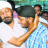A man hugs his son upon his return from the Kashmir Valley at Sri Guru Ramdas airport in Amritsar on Friday