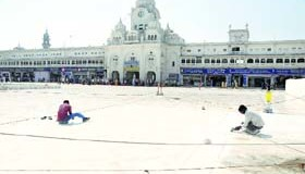 Workers give finishing touches to the Golden Temple entrance plaza in Amritsar