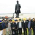 Members of Guru Nanak Darbar Gurdwara, Gravesend, pose in front of the Sikh soldier's statue in London.