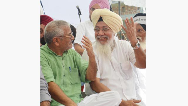 AAP MP from Patiala Dharamvira Gandhi (left) and Harinder Singh Khalsa, Fathegarh Sahib MP during a rally at Baba Bakala.