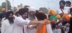 Sarabjit singh dhunda along with Panthpreet giving siropa to Inder Ghana.